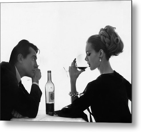 Entertainment Metal Print featuring the photograph Man Gazing at Woman Sipping Wine by Bert Stern