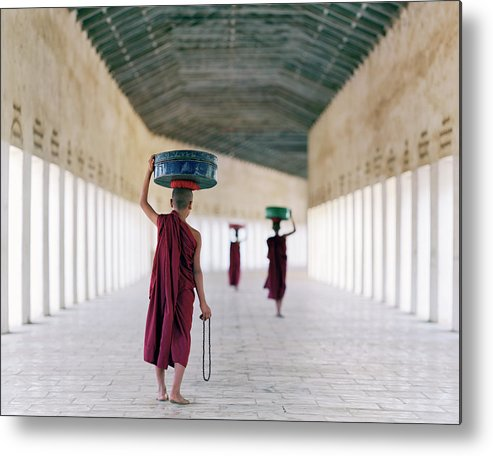 Child Metal Print featuring the photograph Myanmar, Bagan, Monks In Temple Corridor by Martin Puddy