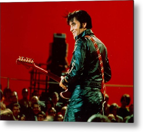 Elvis Presley Metal Print featuring the photograph Rock And Roll Musician Elvis Presley by Michael Ochs Archives