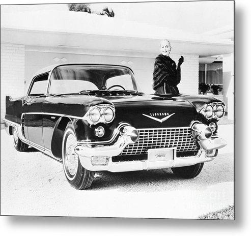 Mid Adult Women Metal Print featuring the photograph 1957 Cadillac Eldorado Brougham by Bettmann