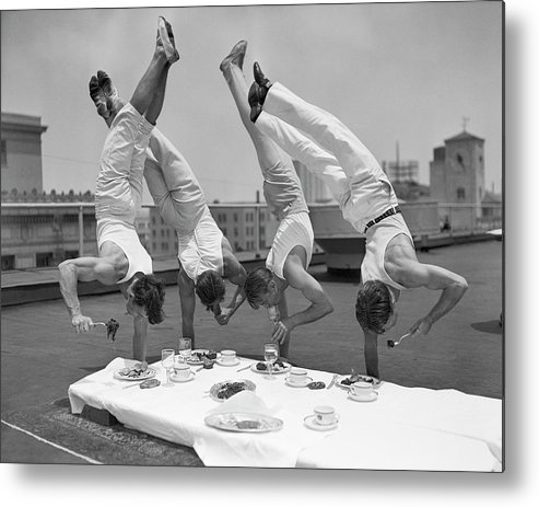 People Metal Print featuring the photograph Acrobats Eat While Doing Handstands by Bettmann