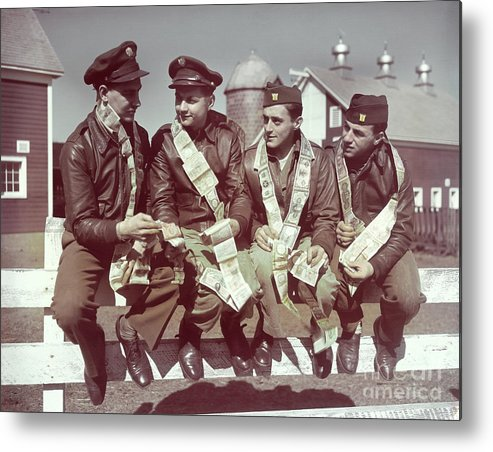 Young Men Metal Print featuring the photograph Air Force Gunners Comparing Short by Bettmann