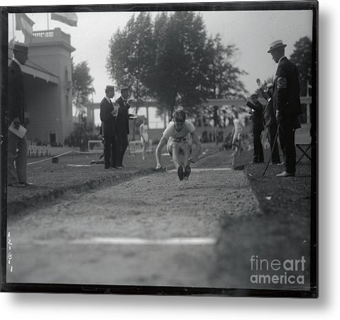 The Olympic Games Metal Print featuring the photograph Carl Johnson Making His Jump In Olympic by Bettmann
