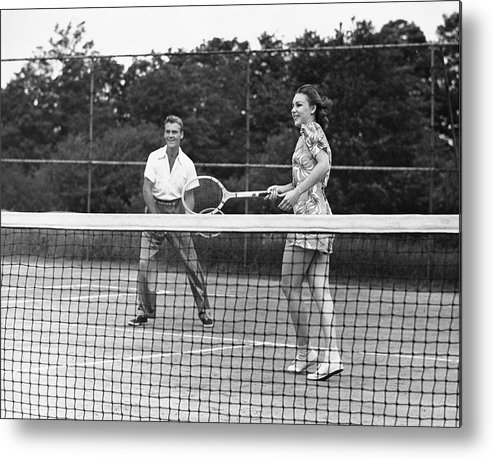 Heterosexual Couple Metal Print featuring the photograph Couple Playing Tennis by George Marks
