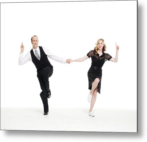 Heterosexual Couple Metal Print featuring the photograph Dance Couple Doing A Lindyhop Dance Move by Allison Michael Orenstein