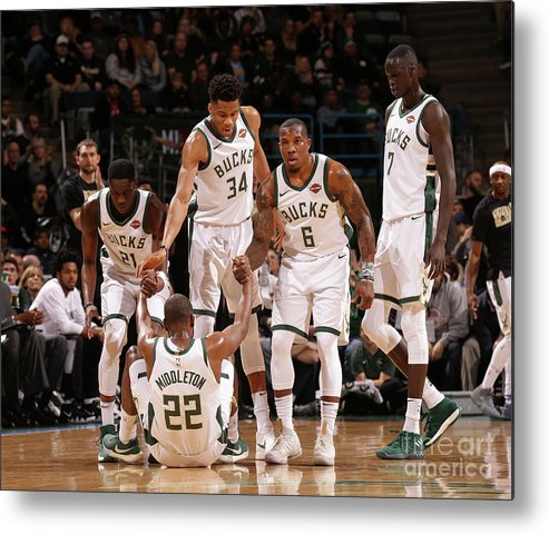 Assistance Metal Print featuring the photograph Denver Nuggets V Milwaukee Bucks by Nba Photos