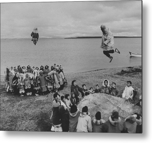 Timeincown Metal Print featuring the photograph Eskimos Using Homemade Trampolines To Ce by Ralph Crane