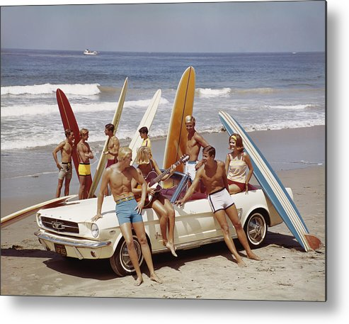 Young Men Metal Print featuring the photograph Friends Having Fun On Beach by Tom Kelley Archive