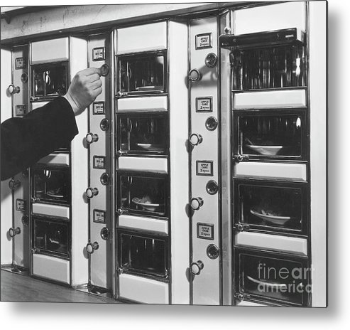 Coin Metal Print featuring the photograph Hand Placing Coin Into Automat Lunch by Bettmann