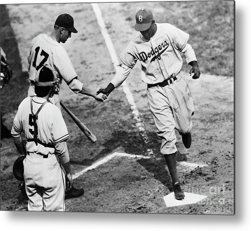 First Baseman Metal Print featuring the photograph Jackie Robinson At Home Plate, 1947 by Bettmann