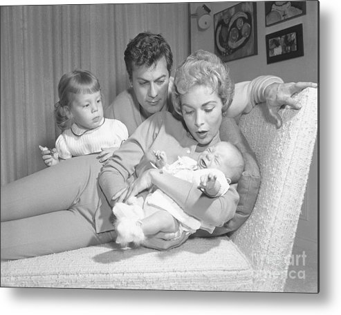 Mid Adult Women Metal Print featuring the photograph Janet Leigh Holding Jamie Lee Curtis by Bettmann