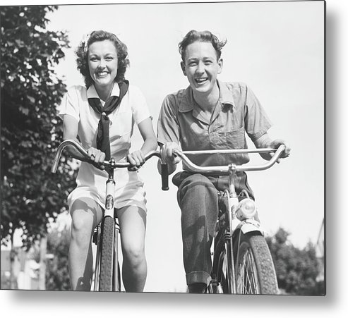 Young Men Metal Print featuring the photograph Man And Woman Riding Bikes, B&w, Low by George Marks