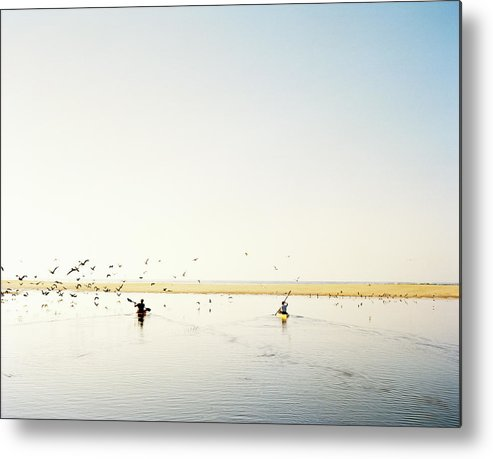 People Metal Print featuring the photograph Men Paddling Kayaks To The Beach by Julien Capmeil