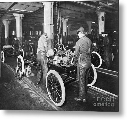 Working Metal Print featuring the photograph Model T Being Assembled In Ford Plant by Bettmann