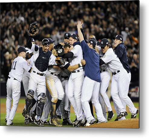 American League Baseball Metal Print featuring the photograph New York Yankees Celebrate After by New York Daily News Archive