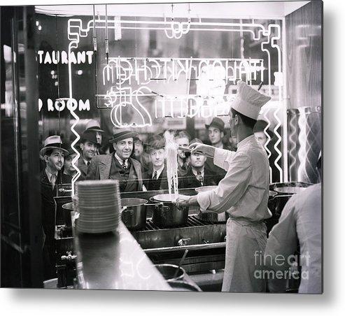 Pedestrian Metal Print featuring the photograph Onlookers Watching Cook In Window by Bettmann