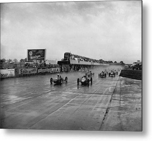 1950-1959 Metal Print featuring the photograph Racing In The Rain by Central Press