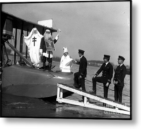 People Metal Print featuring the photograph Santa Claus Arriving On Seaplane by Bettmann