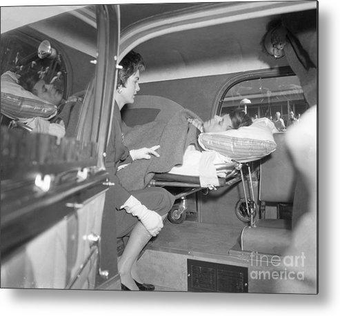 Ambulance Metal Print featuring the photograph Senator John Kennedy In Ambulance by Bettmann