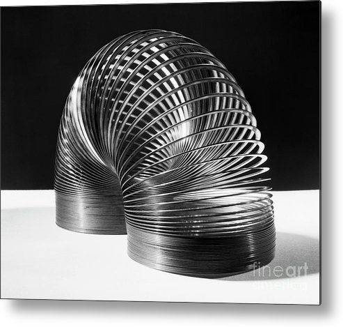 Invention Metal Print featuring the photograph Slinky Toy by Bettmann