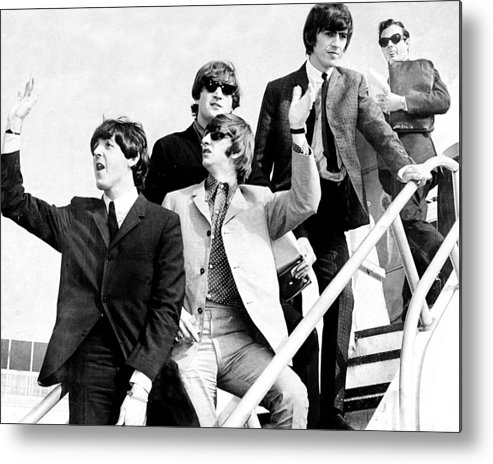 Following Metal Print featuring the photograph The Beatles, L. To R. Paul Mccartney by New York Daily News Archive
