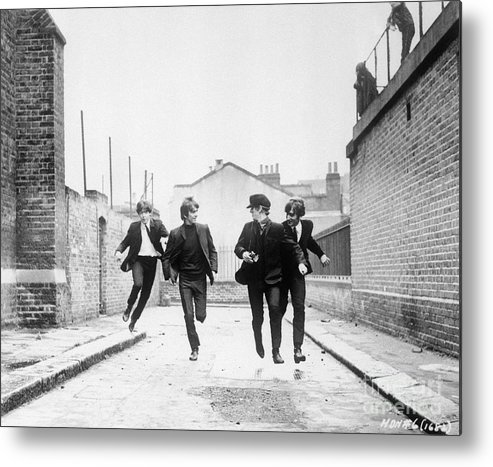 People Metal Print featuring the photograph The Beatles Running In A Hard Days Night by Bettmann