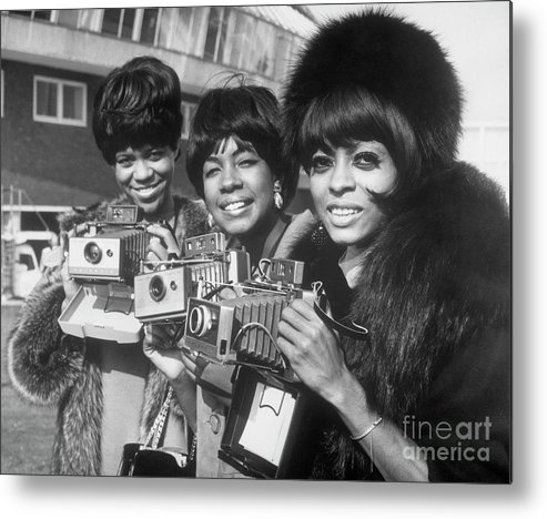 Singer Metal Print featuring the photograph The Supremes With Cameras In London by Bettmann