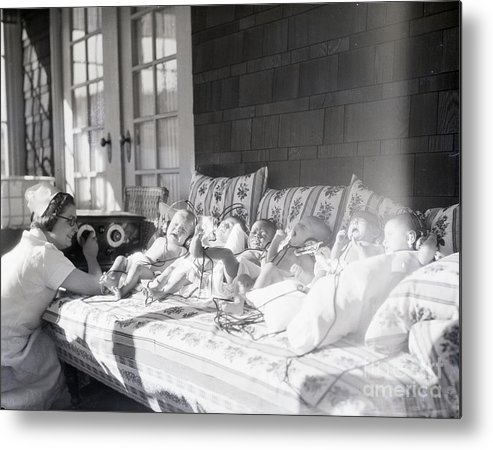 Medical Research Metal Print featuring the photograph Trying To Calm Babies With Radio by Bettmann