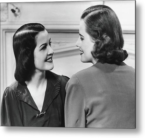 People Metal Print featuring the photograph Two Women Conversing In Living Room, B&w by George Marks