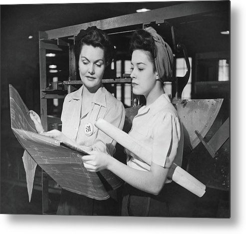 Plan Metal Print featuring the photograph Two Women In Workshop Looking At by George Marks