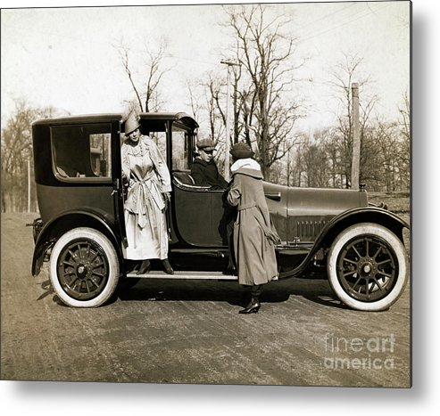 Mid Adult Women Metal Print featuring the photograph Woman Leaving Hired Cadillac by Bettmann
