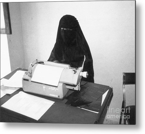 Working Metal Print featuring the photograph Yemeni Woman Typing In Chador And Veil by Bettmann