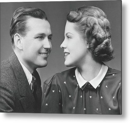 Young Men Metal Print featuring the photograph Young Couple Looking In Eyes In Studio by George Marks