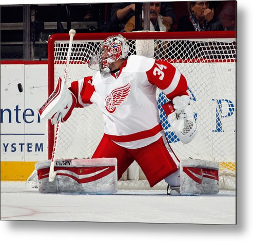 Petr Mrazek Metal Print featuring the photograph Detroit Red Wings v New Jersey Devils by Bruce Bennett