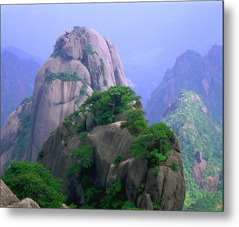 Part Of A Series Metal Print featuring the photograph A Rocky Outcropping Overlooks A Mist-covered China Mountain Range by Rubberball