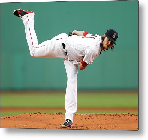 American League Baseball Metal Print featuring the photograph Clay Buchholz by Jim Rogash