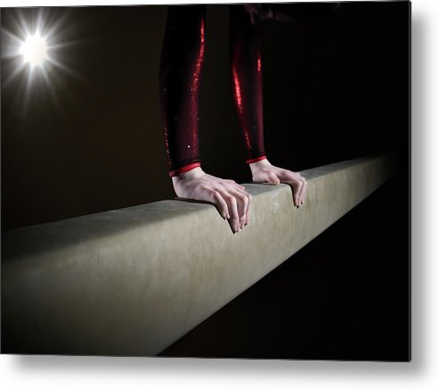 Human Arm Metal Print featuring the photograph Female Gymnast On Balancing Beam by Mike Harrington