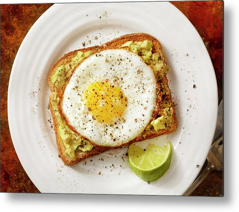 Breakfast Metal Print featuring the photograph Avocado Toast With A Fried Egg by Lauripatterson