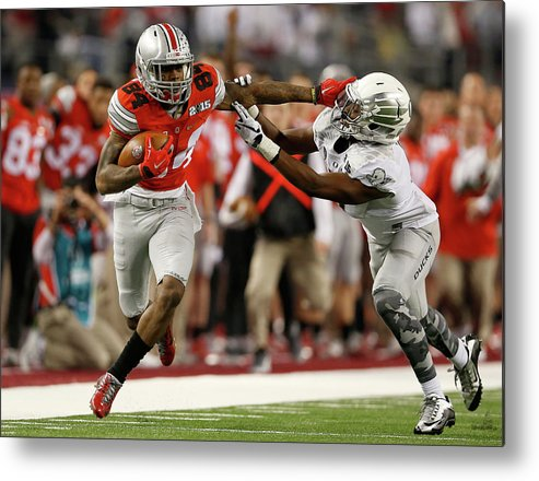 Sport Metal Print featuring the photograph National Championship - Oregon V Ohio by Christian Petersen