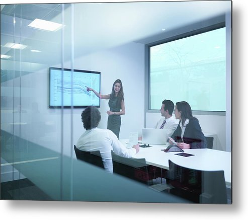 Working Metal Print featuring the photograph View Through Glass Wall Of Business by Monty Rakusen