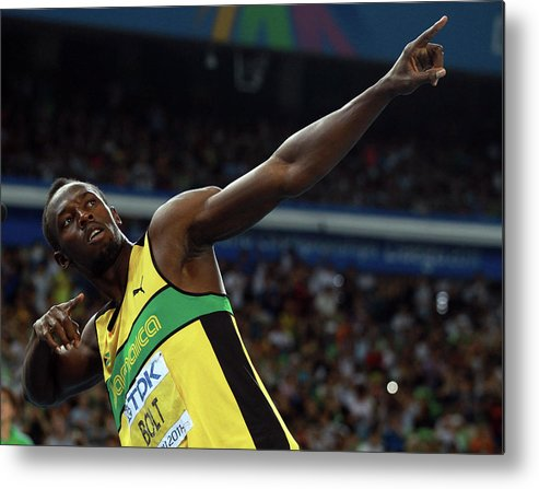 Usain Bolt 'to Di World' Pose Metal Print featuring the photograph 13th Iaaf World Athletics Championships by Alexander Hassenstein