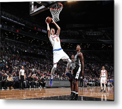 Nba Pro Basketball Metal Print featuring the photograph New York Knicks V Brooklyn Nets by Nathaniel S. Butler