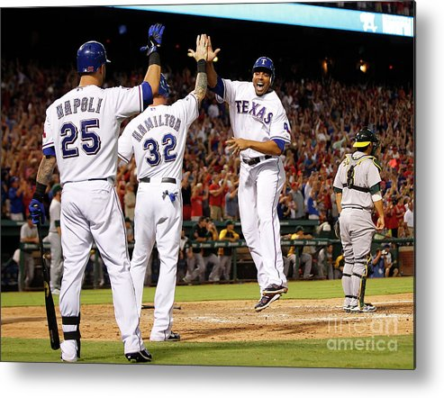 American League Baseball Metal Print featuring the photograph Oakland Athletics V Texas Rangers by Rick Yeatts
