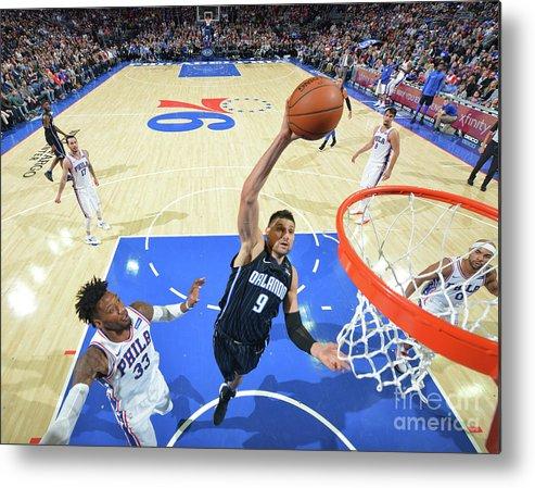 Nba Pro Basketball Metal Print featuring the photograph Philadelphia 76ers V Orlando Magic by Jesse D. Garrabrant