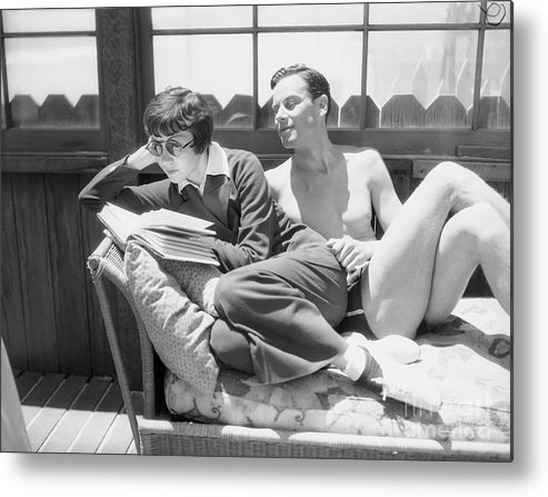 Norman Foster Metal Print featuring the photograph Claudette Colbert With Norman Foster by Bettmann