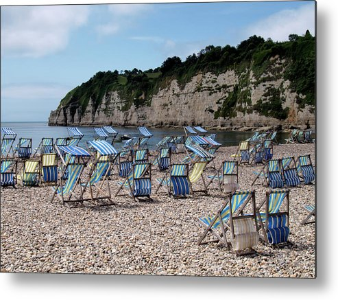 Tranquility Metal Print featuring the photograph Deckchairs At Beer, Devon, Uk 2013 by Nik Taylor