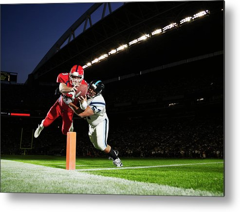 Sports Helmet Metal Print featuring the photograph Football Player Diving Into End Zone by Thomas Barwick