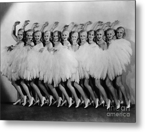 Dozen Metal Print featuring the photograph Line Of Chorus Girls In Feathered by Bettmann