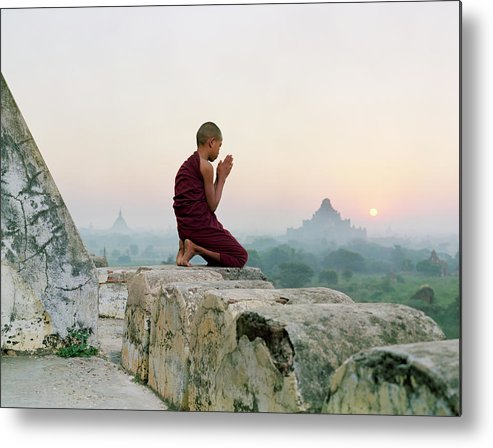 Child Metal Print featuring the photograph Myanmar, Bagan, Buddhist Monk Praying by Martin Puddy