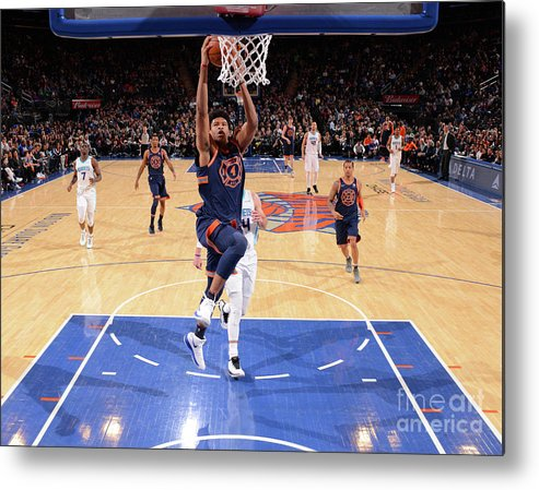 Description Metal Print featuring the photograph New York Knicks V Charlotte Hornets by Jesse D. Garrabrant